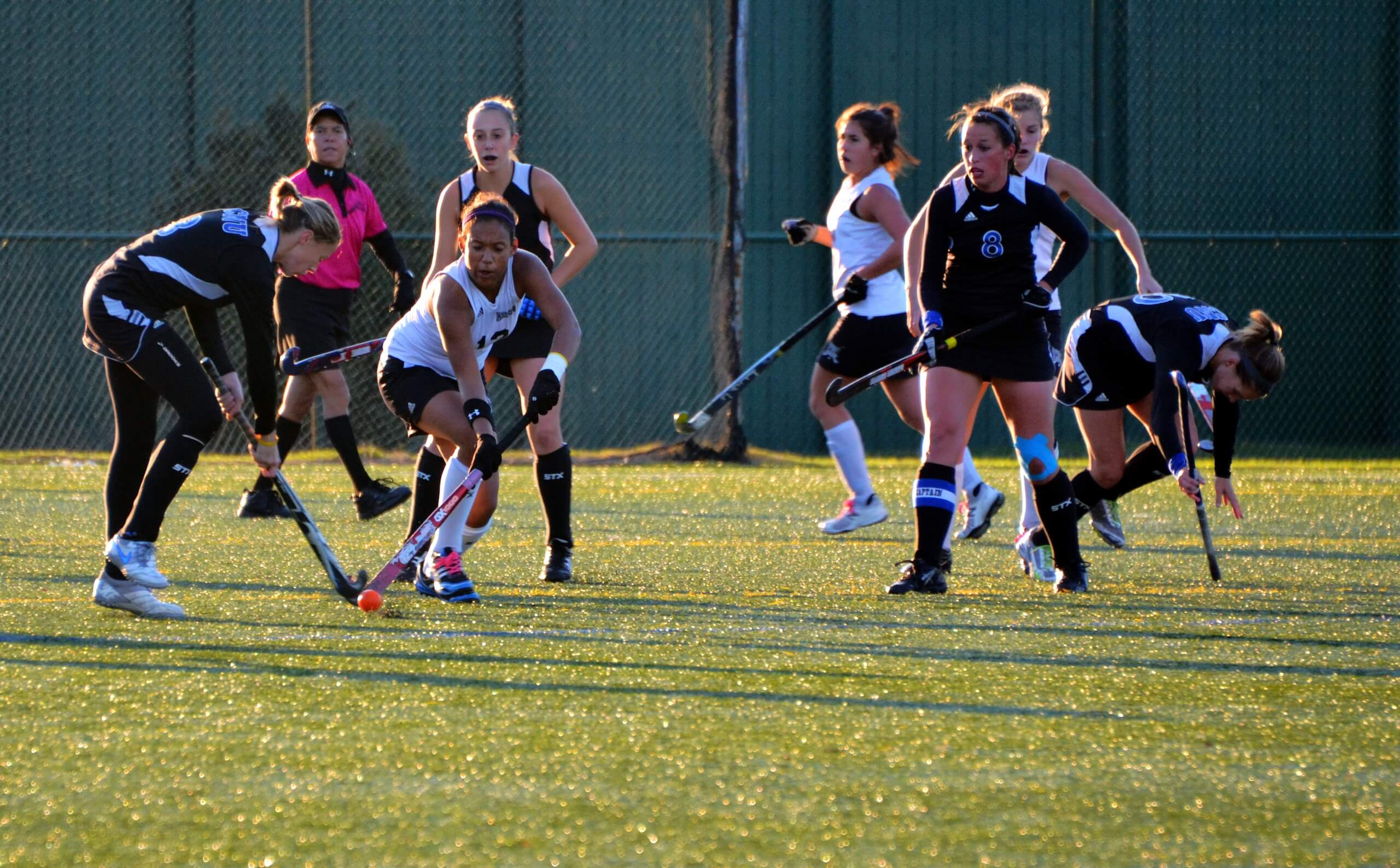 Girls on a hockey tour play a game of field hockey