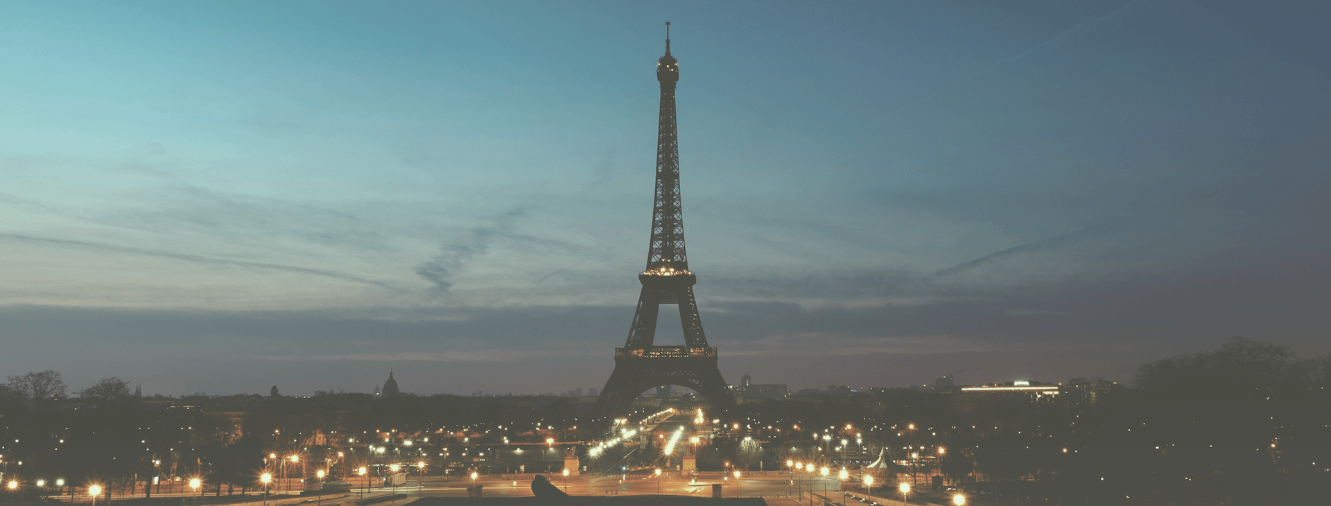 Beautiful night time shot of the Eiffel Tower over Paris