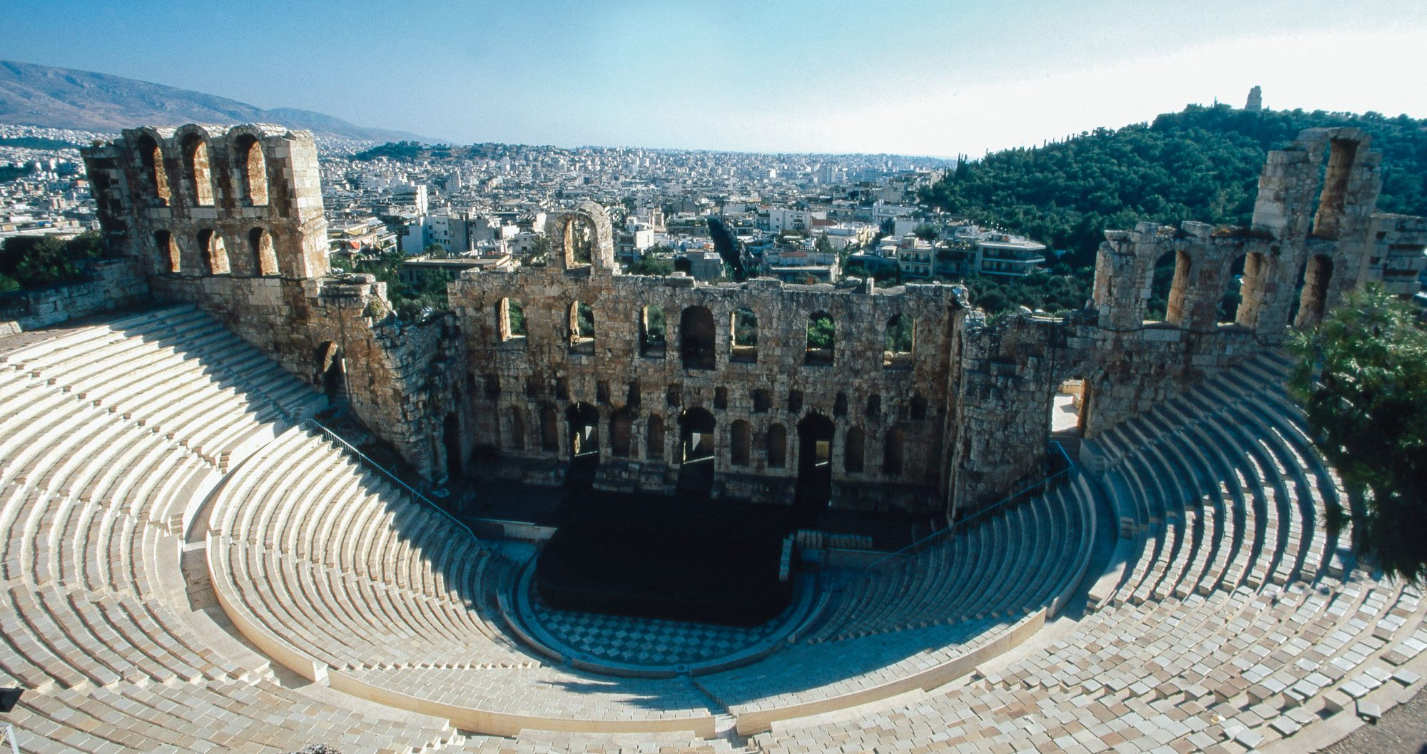The Odeon of Herodes Atticus is a theatre adjacent to the Acropolis of Athens in Greece