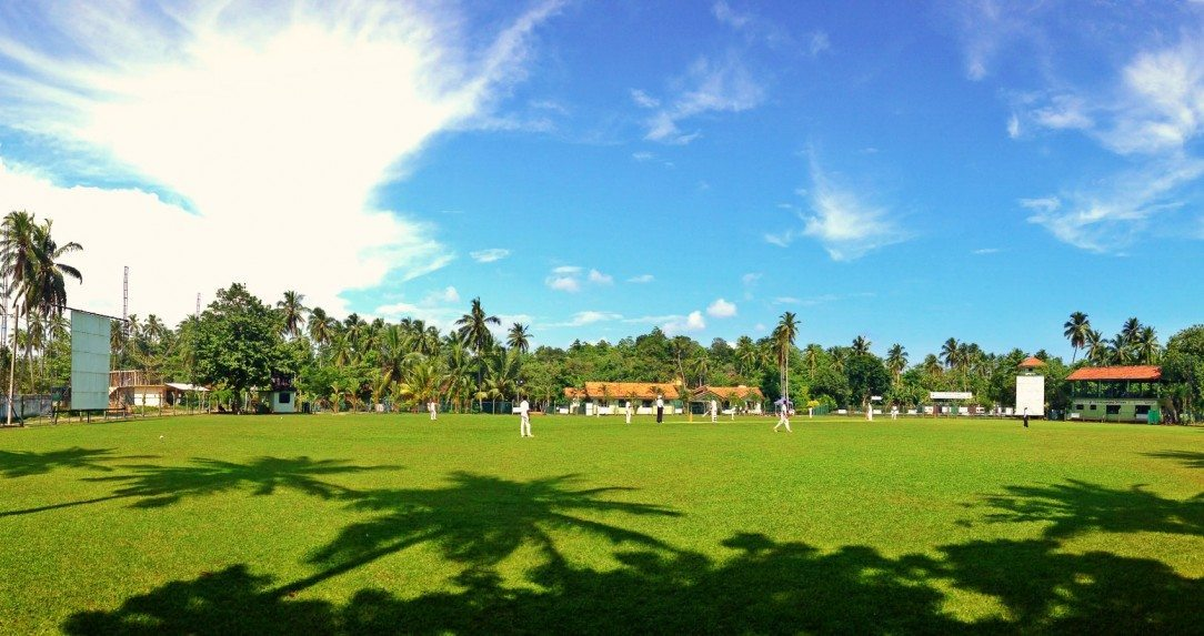 Boys on a school cricket tour playing at the Seenigama Oval in Sri Lanka