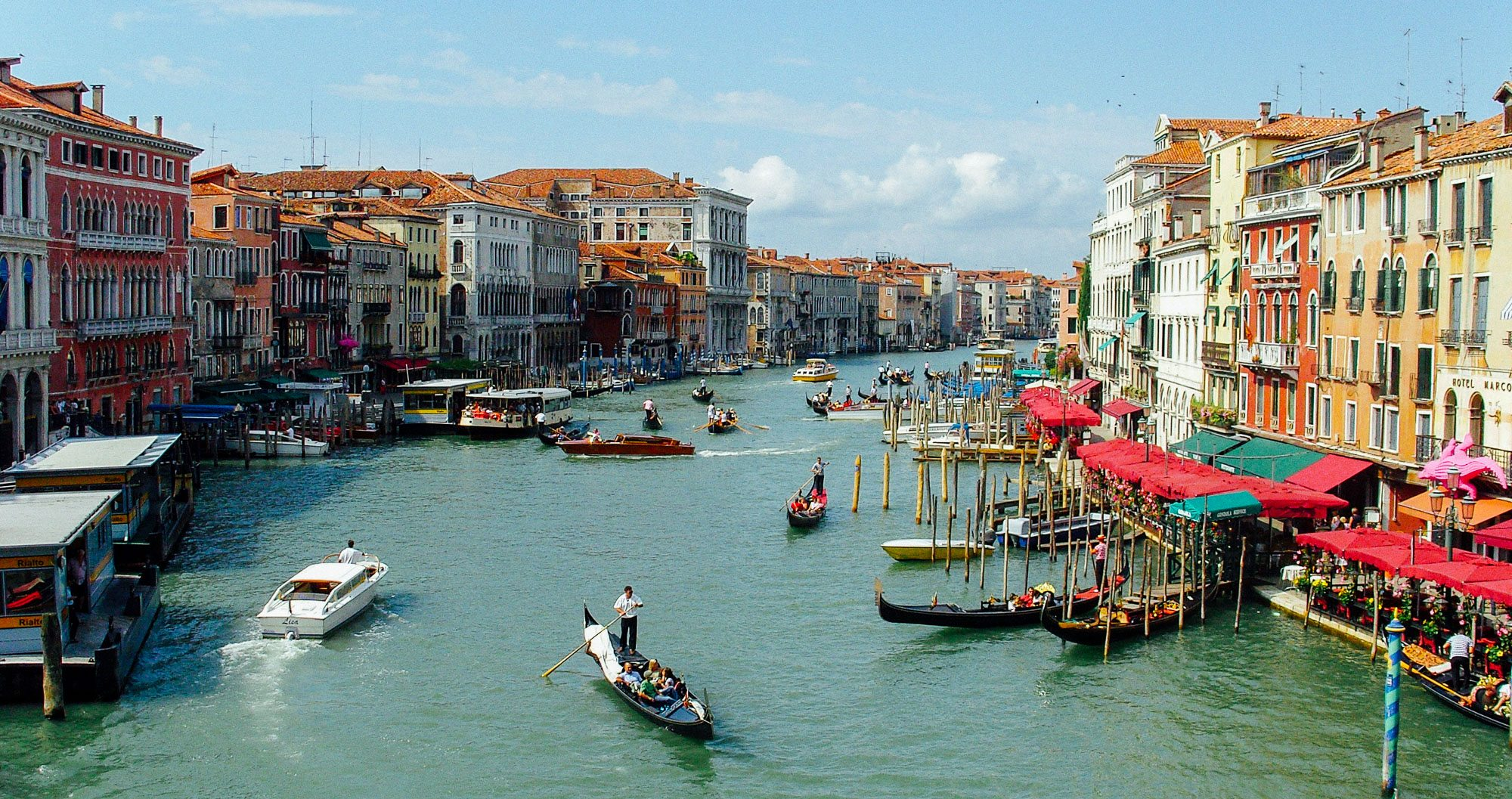 Teams on their sports tour unwind on a recreational day by taking a gondala ride through Venice