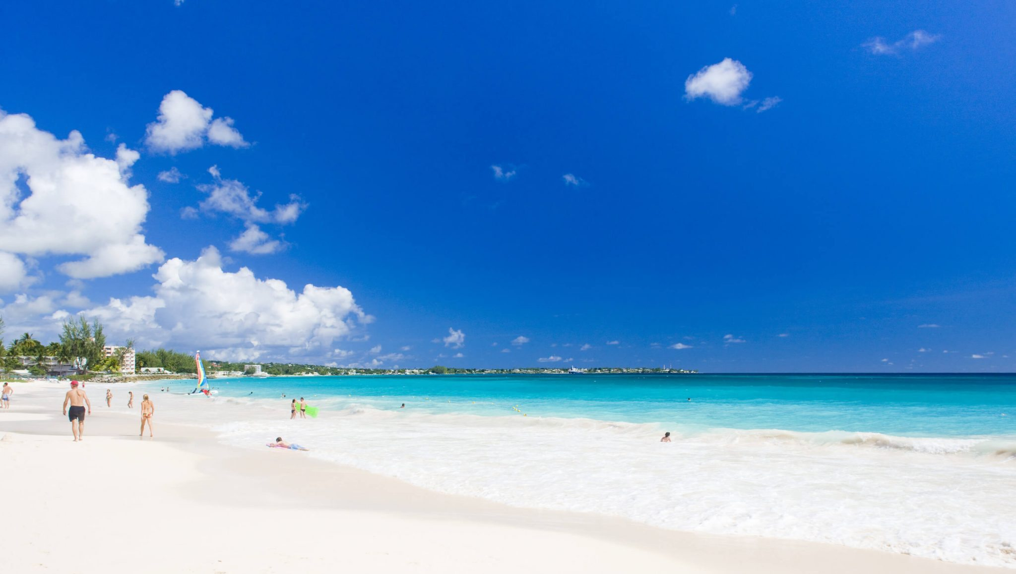 Tourists relax on the beach in Barbados